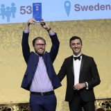 "Andreas from Netlight receiving the trophy from ""Great Place to Work"" on behalf of Netlight"